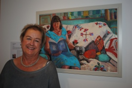 Lucinda Rendall with her portrait of Julian Warrender